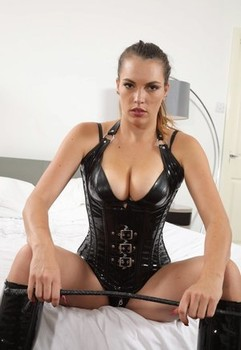 Hot girl Dominika C frees her natural tits and ass from a PVC corset in boots