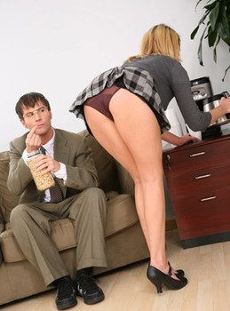 Busty chick Codi Carmichael seduces a man at work with an upskirt panty flash