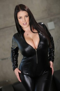 Curvy brunette lady Angela White unzips her bodysuit & reveals her giant tits