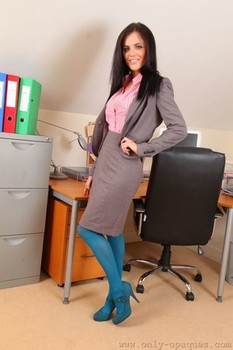 Sexy secretary Emma Glover exposes her big juggs as she strips to pantyhose