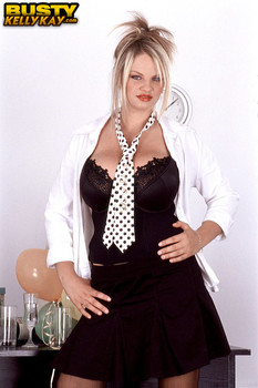 Huge boobed blonde Kelly Kay pinches and licks her nipples on the desk