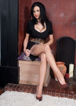 Hot brunette Louise Jenson shows off her great legs and feet in retro nylons