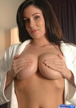 Busty brunette Sweet Krissy bending over & showing cameltoe in white panties