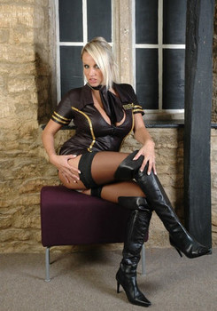 Sexy blonde MILF Dannii Harwood reveals great big tits outdoors in thigh boots