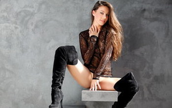 Stunning brunette Lorena G in thigh high boots displays super hot ass naked