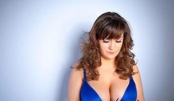 Amateur model Hannah Sharp takes off her glasses for several lingerie changes