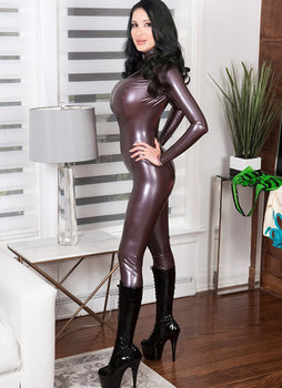 Solo girl Ariane Saint-Amour flaunts her huge tits as she changes latex attire