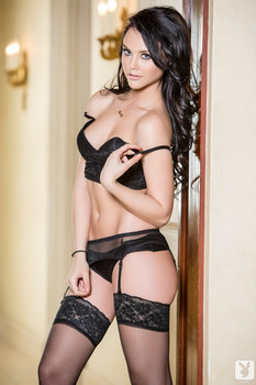 Hot brunette Iana Little strips to black stockings and poses seductively
