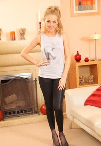 Sexy blonde Lucy Anne removes black leggings on her way to posing topless