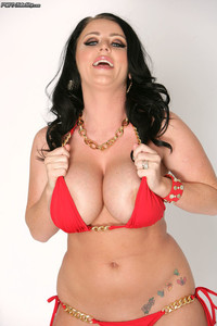 Curvy brunette Sophie Dee frees her huge boobs from bikini at The Madison's