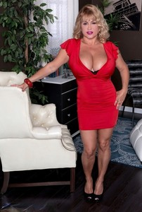 Sexy blonde model in a red dress unleashes her massive boobs