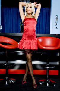 Blonde honey in a red dress Natasha Marley flaunts her curves in stockings