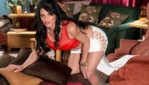 Beautiful mature lady Jade Steele peels off miniskirt as she begins to undress