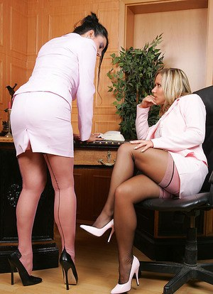 Horny businesswomen play with twats after stripping to nylons and lingerie