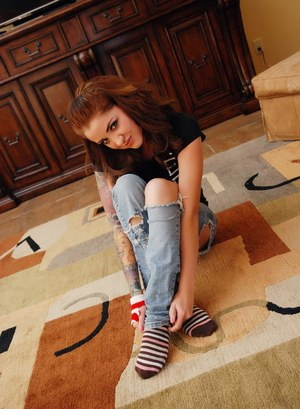 Hot young redhead Jeska Vardinski removes her jeans to toy with a dildo