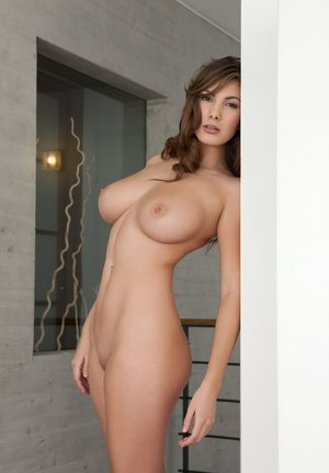 Sexy brunette chick Josephine shows off her large boobs during nude poses