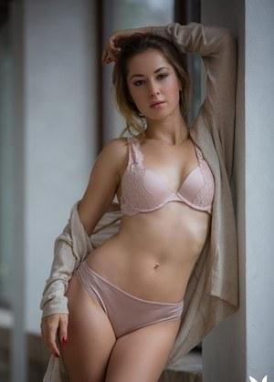 Centerfold model Diana Lark frees her thin body from lingerie in knee socks