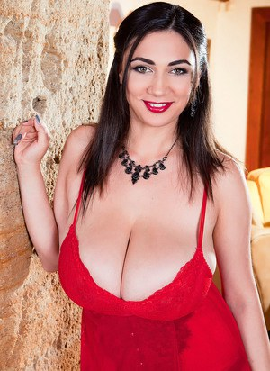 Beautiful big titted Alexya looses her huge knockers to pose in stockings