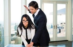 Dark haired secretary Megan Rain removes her glasses while banging her boss