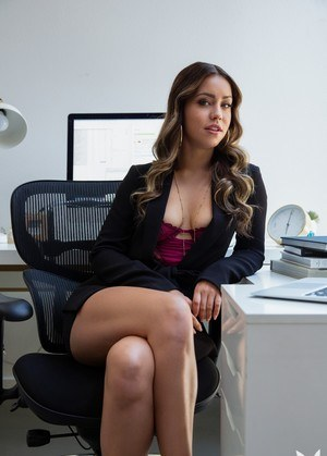 Leggy secretary Alina Lopez strips naked on top of her desk for Playboy