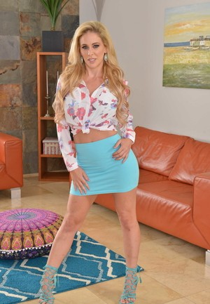 Blonde American housewife Cherie DeVille strips to her high heeled shoes