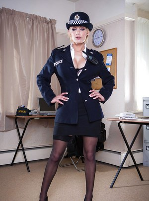Uniformed police babe Loulou showing her big natural titties