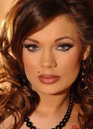 Brunette Euro beauty Kyla Fox in satin lingerie strips to pose naked