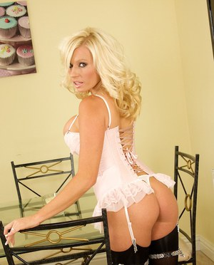 Hot MILF Michelle Thorne poses in the sexiest of black stockings
