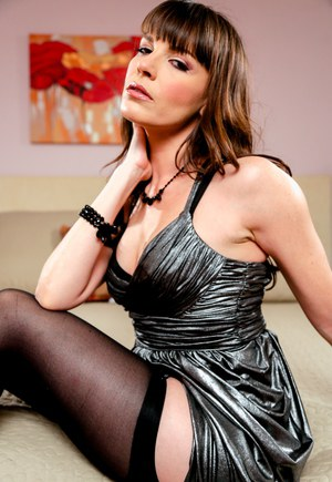 Brunette MILF Dana DeArmond takes off her short dress in nylons and garters