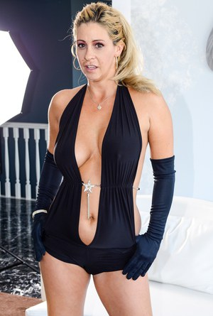 Blonde female Phyllisha Anne exposes her big tits in velvet gloves and boots