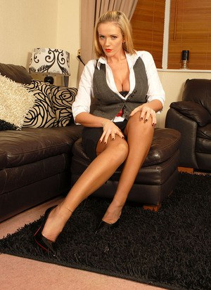 Big boobed blonde Lucy Zara dildos her pussy in nylons and red soled heels