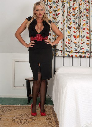 Big titted blonde Lucy Zara shows her snatch in girdle corset and nylons