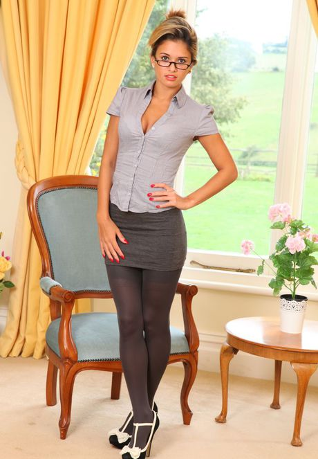 Hot secretary Danni B slips miniskirt over her nice ass in opaque stockings