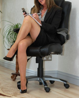 Mature secretary Satin Jayde can't resist showing off her best assets at work