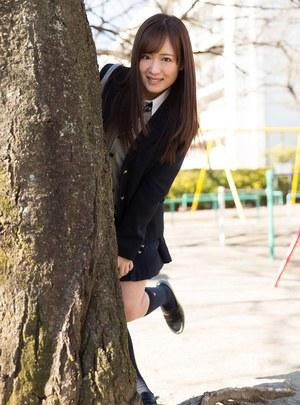 Japanese schoolgirl pulls down her cotton underwear during upskirt action