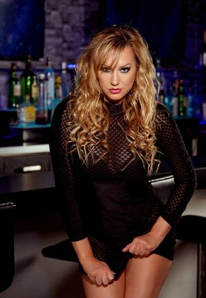 Sexy blonde Brett Rossi strips to red pumps inside a cocktail bar