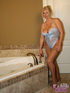 Thick blonde Karen Fisher wears lingerie and stockings to take a bath