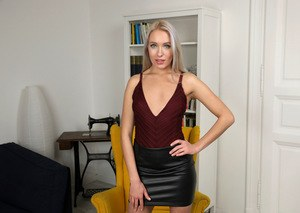 Solo girl Angelika Grays masturbates after removing leather dress and bodysuit