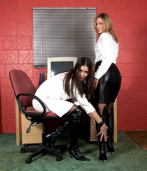 Hot chicks in black boots grab hold of each others bare ass