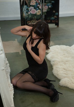 Clothed brunette pornstar Lucy Love A strutting in stockings and high heel