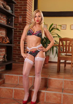 Hot blonde Tracy shows her beautiful ass in white nylons and garters