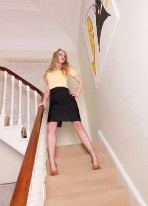 Solo model Lucy Lume strips to back seam nylons and garters on the stairs