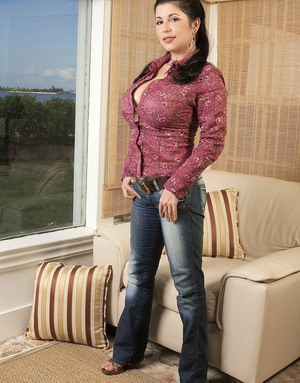 Beautiful older woman Natalie Fiore uncovers her nice melons while undressing