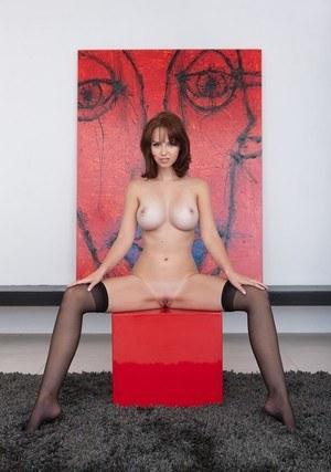 Busty erotic Hayden W in black stockings bending to let her hot big tits hang