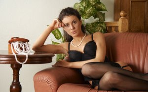 Glamour model Terri disrobes to pose erotically in stockings & pearls