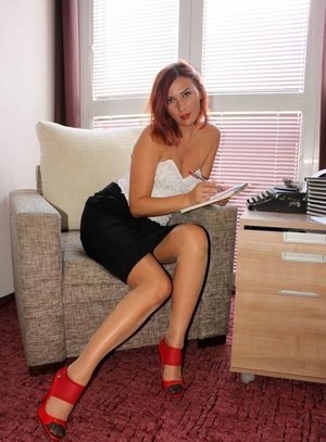 Natural redhead takes off her black skirt and red heels in RHT nylons