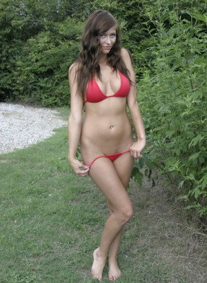 Big tit amateur model London Hart strips off her sexy red bikini outdoors