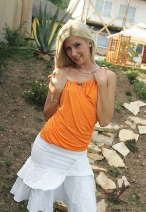 Playful blonde Jenny Sanders strips at the backyard and spreads hot ass cheeks
