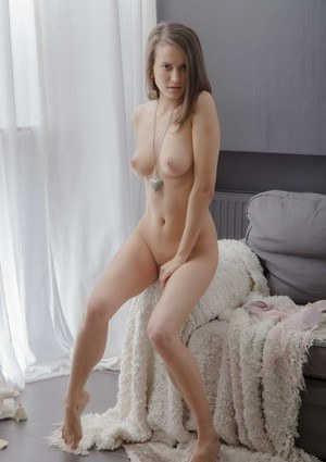 Teen solo girl Nika pets her pussy after showing her beautiful breasts
