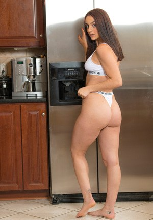 Amateur girl Shelby Mayne grabs her bare ass while rummaging in a fridge